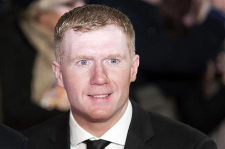 "Soccer player Paul Scholes attends the world premiere of the film ""The Class of 92"" in London December 1, 2013. REUTERS/Neil Hall/Files"