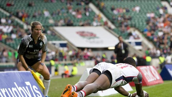 Perry Baker scores a try during the London Sevens rugby union cup final match between USA and Australia on May 17, 2015
