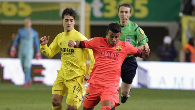 Barcelona's Rafinha and Villarreal's Trigueros fight for the ball during their Spanish King's Cup semi-final second leg soccer match at the Madrigal stadium in Villarreal