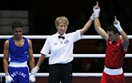 Nordine Oubaali (R) of France is declared winner over Ajmal Faisal (L) of Afghanistan in their first round Flyweight (52kg) match of the London 2012 Olymipic Games at the Excel Arena in London. Oubaali was awarded a 22-9 points decision