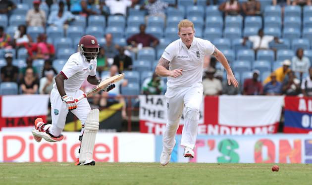 Cricket: England's Ben Stokes fields off his own bowling as West Indies  Jermaine Blackwood goes through for a single