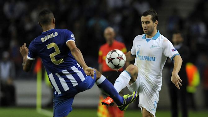 Zenit's Aleksandr Kerzhakov, right, vies with Porto's Danilo Silva, from Brazil, during the Champions League group G soccer match between FC Porto and Zenit Tuesday, Oct. 22, 2013, at the Dragao stadium in Porto, northern Portugal. Kerzhakov scored the only goal in Zenit's 1-0 victory