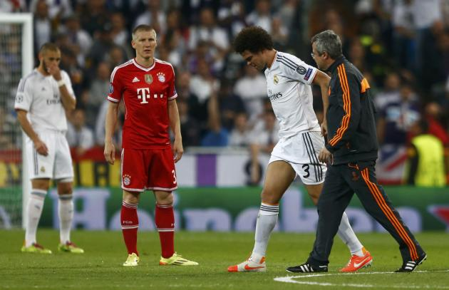 Real Madrid's Pepe is helped from the pitch after being injured during Champion's League semi-final first leg soccer match against Bayern Munich in Madrid