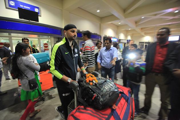 India's bowler Harbhajan Singh, centre, is surrounded by fans upon his arrival at Harare International airport in Harare, Zimbabwe, Tuesday, July 7, 2015. The Indian Cricket team is in Zimbabwe fo