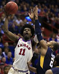 Kansas guard Josh Jackson (11) shoots while covered by West Virginia guard Jevon Carter (2) during the first half of an NCAA college basketball game in Lawrence, Kan., Monday, Feb. 13, 2017. (AP Photo/Orlin Wagner)