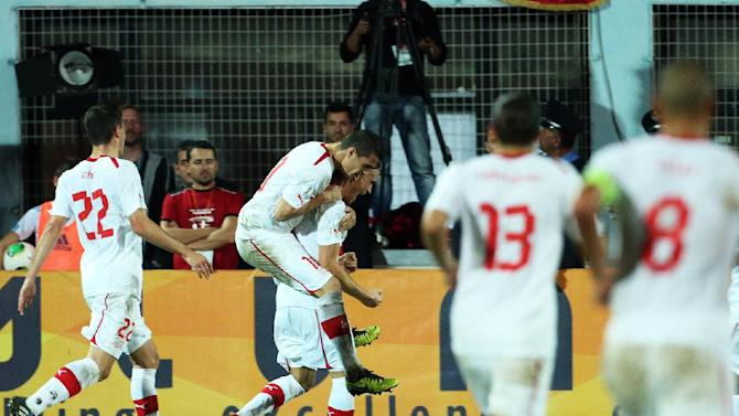 Switzerland's players celebrates after scoring (2-0) in a World Cup Group E qualifier versus host Albania in Tirana, Friday, Oct. 11, 2013