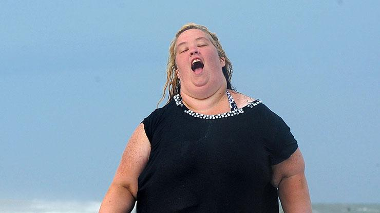 EXCLUSIVE: **NO WEB until 1 pm PST June 12**Mama June Shannon runs on the beach with a lifeguard buoy in Tybee, GA