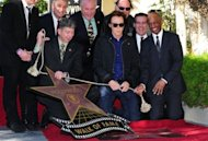 Music legend Paul McCartney watches as his star on the Hollywood Walk of Fame is unveiled. Receiving the 2,460th Star on the famed walkways of Hollywood, McCartney's star is lined up alongside his fellow Beatles, John Lennon, George Harrison and Ringo Starr