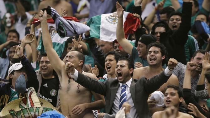 Mexico's fans celebrate a win over Panama during their 2014 World Cup qualifying soccer match at Azteca stadium in Mexico City