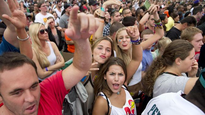 """Fans cheer during the """"Made In America"""" music festival on Sunday Sept. 2, 2012, in Philadelphia. (Photo by Drew Gurian/Invision/AP)"""