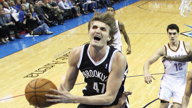 Brooklyn Nets forward Andrei Kirilenko (47) collides with Oklahoma City Thunder guard Derek Fisher (6) as he goes up for a shot in the fourth quarter of an NBA basketball game in Oklahoma City, Thursday, Jan. 2, 2014. Oklahoma City won 95-93