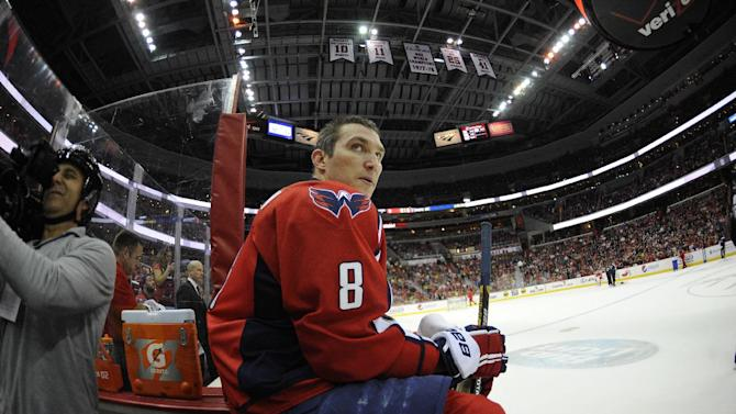 In this photo taken with a fisheye lens, Washington Capitals right wing Alex Ovechkin (8), of Russia, looks on during a break in the action in the first period of an NHL hockey game against the Boston Bruins, Saturday, March 29, 2014, in Washington