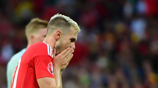 Arsenal midfielder Aaron Ramsey to miss World Cup Qualifying double-header with hamstring injury
