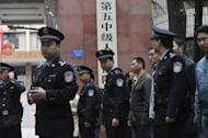 Chinese police stand guard outside the court in Chongqing prior to the verdict on the trial of mafia kingpin Wen Qiang in 2010. Bo Xilai was known for cracking down on organised crime in Chongqing, where ruthless mafia kingpins ran rampant for years
