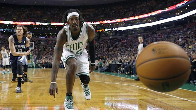 The ball goes out of bounds off Boston Celtics' Gerald Wallace (45) as Memphis Grizzlies' Mike Miller (13) looks on in the second quarter of an NBA basketball game in Boston, Wednesday, Nov. 27, 2013. The Grizzlies won 100-93