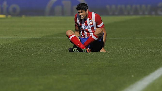 Atletico de Madrid's Diego Costa from Brazil sits during a Spanish La Liga soccer match against Celta de Vigo at the Vicente Calderon stadium in Madrid, Spain, Sunday, Oct. 6, 2013