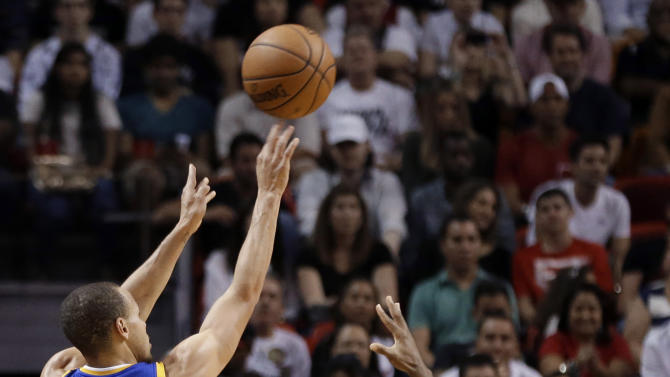 Golden State Warriors' Stephen Curry (30) shoots a 3-point basket as Miami Heat's Norris Cole, right, defends during the first half of an NBA basketball game, Thursday, Jan. 2, 2014, in Miami. (AP Photo/Lynne Sladky)