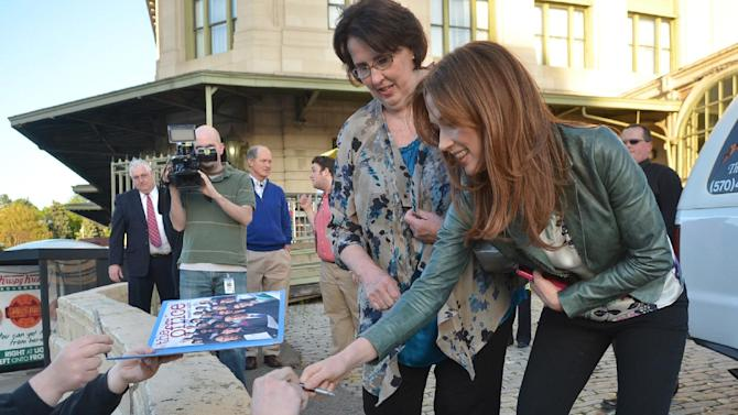 "The ""Office"" actors, Phyllis Smith and Ellie Kemper, sign autographs outside the Radisson Lackawanna Station Hotel,  Friday, May 3, 2013 in Scranton, Pa. The cast and crew are in town for the Office Wrap Party, a day of events celebrating the show and its ties to Scranton as it comes to an end.  (AP Photo/Scranton Times & Tribune, Jason Farmer)  WILKES BARRE TIMES-LEADER OUT; MANDATORY CREDIT"