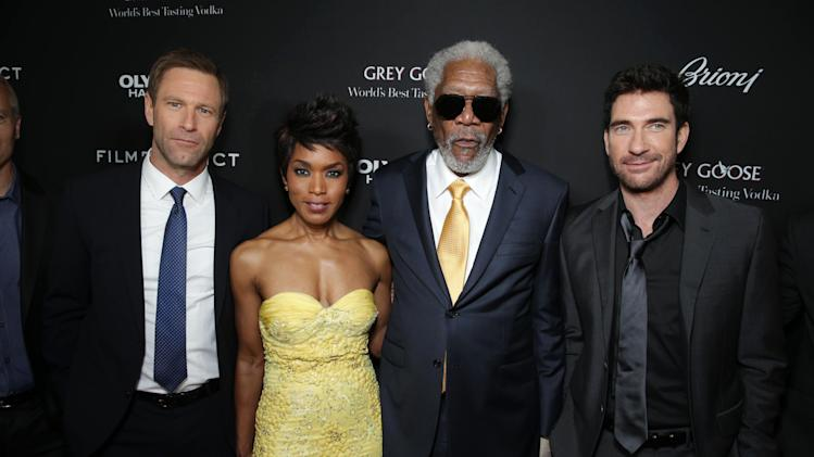 Aaron Eckhart, Angela Bassett, Morgan Freeman and Dylan McDermott at FilmDistrict's Premiere of 'Olympus Has Fallen' hosted by Brioni and Grey Goose at the ArcLight Hollywood, on Monday, March, 18, 2013 in Los Angeles. (Photo by Eric Charbonneau/Invision for FilmDistrict/AP Images)