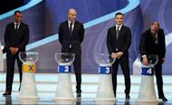Former England soccer player Geoff Hurst (R) draws a ball from a pot as former Brazil player Cafu (L), former France player Zinedine Zidane (2nd L) and former Italy player Fabio Cannavaro look on during the draw for the 2014 World Cup at the Costa do Sauipe resort in Sao Joao da Mata, Bahia state, December 6, 2013. REUTERS/Sergio Moraes