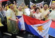 Taiwanese fishermen chant slogans at the Philippine de facto embassy in Taipei during a protest on May 13, 2013. Angry Taiwanese fishermen burned Filipino flags in protest Monday after the Philippine coastguard fired on a Taiwan fishing boat killing a crew member