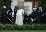Pope Francis plants an olive tree with Israel's President Shimon Peres, right, Palestinian President Mahmoud Abbas, second from right, and Ecumenical Patriarch Bartholomew I, left, in a sign of peace during an evening of peace prayers in the Vatican gardens, Sunday, June 8, 2014. Pope Francis waded head-first into Mideast peace-making Sunday, welcoming the Israeli and Palestinian presidents to the Vatican for an evening of peace prayers just weeks after the last round of U.S.-sponsored negotiations collapsed. (AP Photo/Gregorio Borgia)