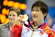 Gold medalist China's Ye Shiwen holds her medal after the podium ceremony of the women's 200m individual medley final during the swimming event at the London 2012 Olympic Games on July 31, 2012 in London