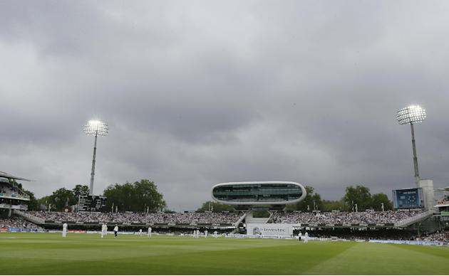 The flood lights light the pitch during the third day of the first Test match between England and New Zealand at Lord's cricket ground in London, Saturday, May 23, 2015. (AP Photo/Kirsty Wiggleswo