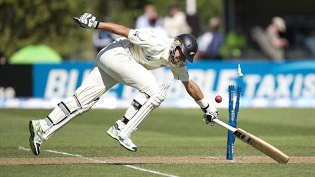 Ross Taylor of New Zealand just makes it in safely against the West Indies in Dunedin (AFP)