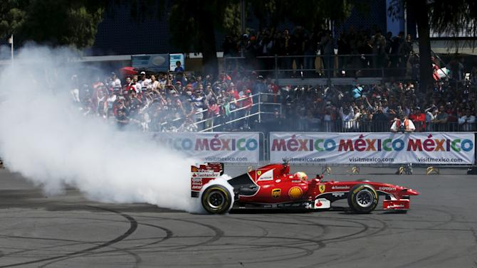 Ferrari Formula One driver Gutierrez of Mexico performs promotional laps along Reforma Avenue in Mexico City
