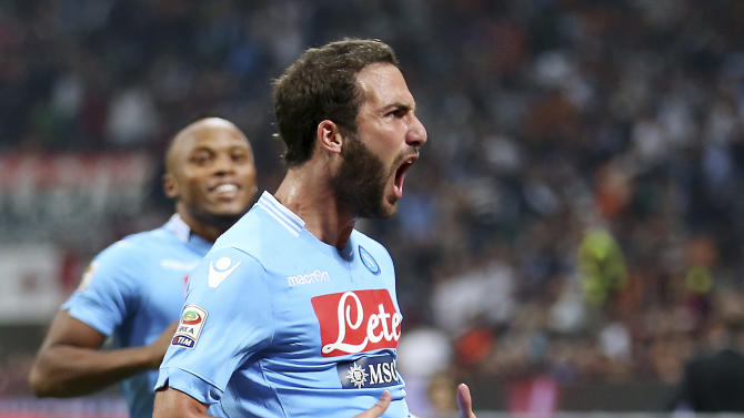 Napoli forward Gonzalo Higuain, right, of Argentina, celebrates after scoring his side's second goal during the Serie A soccer match between AC Milan and Napoli at the San Siro stadium in Milan, Italy, Sunday, Sept. 22, 2013