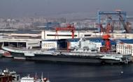 China's first aircraft carrier, the Liaoning, is berthed at the northeastern port of Dalian in September 2012. China has conducted the first landing of a fighter jet on its new aircraft carrier in a move that extends Beijing's ability to project its growing military might in territorial disputes