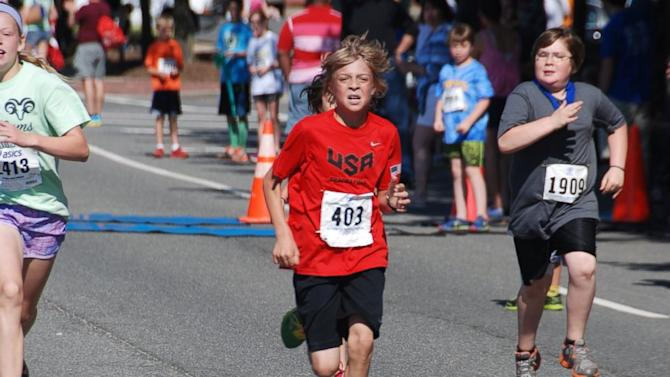 10-Year-Old Breaks Half Marathon World Record for His Age