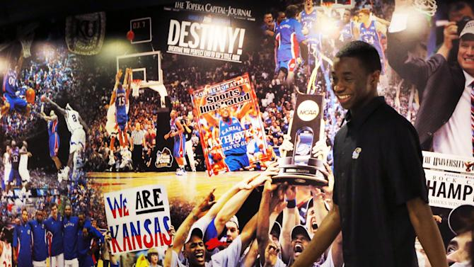 Kansas freshman NCAA college basketball player Andrew Wiggins leaves a news conference at the University of Kansas in Lawrence, Kan., Monday, March 31, 2014. Wiggins announced he would be entering the NBA draft