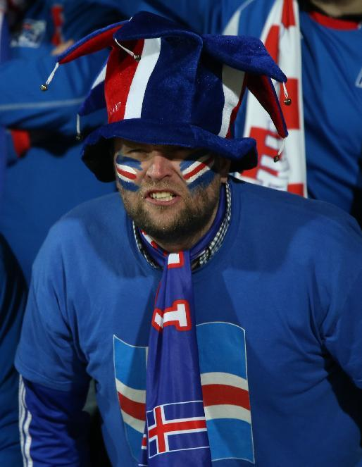 An Iceland fan watches the World Cup qualifying playoff first leg soccer match against Croatia in Reykjavik, Iceland, Friday Nov. 15, 2013