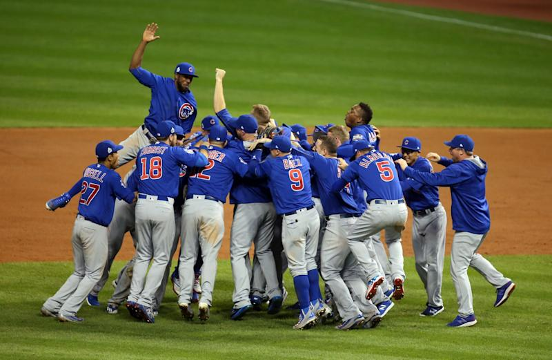 The Cubs celebrate after getting the final out to win the World Series. (USA Today)