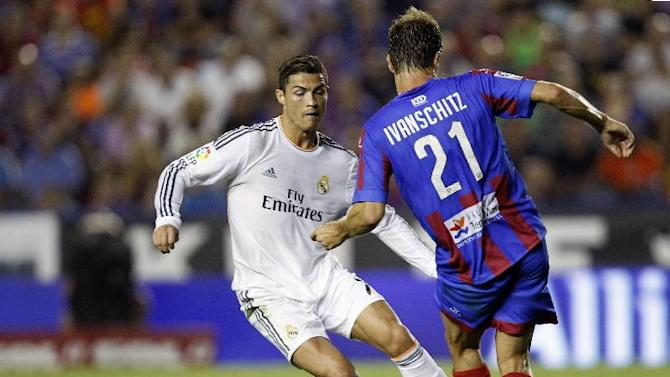 Real Madrid's Cristiano Ronaldo from Portugal duels for the ball with Levante's Andreas Ivanschitz from Austria during their La Liga soccer match at the Ciutat de Valecia stadium in Valencia, Spain, Saturday, Oct. 5, 2013