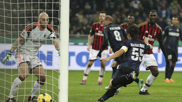 AC Milan goalkeeper Christian Abbiati, left, looks at the ball heading into the net as Inter Milan forward Rodrigo Palacio scores, during the Serie A soccer match between Inter Milan and AC Milan at the San Siro stadium in Milan, Italy, Sunday, Dec. 22, 2013. A late goal from Rodrigo Palacio gave Inter Milan a 1-0 win over city rival AC Milan in an entertaining derby match in Serie A on Sunday. Palacio struck four minutes from time to send three quarters of San Siro into a frenzy