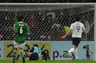 French striker Olivier Giroud scores during the International friendly football match Germany vs France in the northern German city of Bremen. France won 2-1