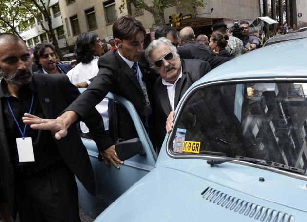 Jose Mujica gets into his Volkswagen Beetle after handing over the presidential sash to Tabare Vazquez in Montevideo