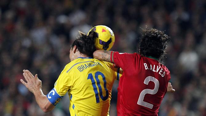 Sweden's Zlatan Ibrahimovic, left, goes for a header with Portugal's Bruno Alves during a World Cup qualifying first leg playoff soccer match between Portugal and Sweden at the Luz stadium in Lisbon, Portugal, Friday, Nov. 15, 2013