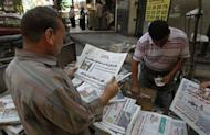 "Egyptians read local newspapers headlining the health situation of ousted president Hosni Mubarak. Egypt's state television carried a ticker item saying Mubarak was in ""a coma and is not clinically dead."""