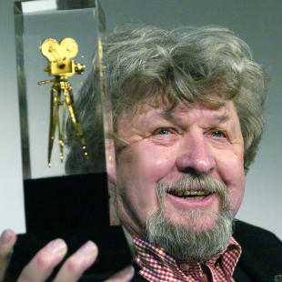 FILE - In this Feb. 2, 2004 file photo Czech director of photography Miroslav Ondricek holds the trophy of The American Society of Cinematographers in Prague, Czech Republic. Ondricek, who was twice nominated for Academy Awards for the movies he made with his friend, director Milos Forman has died. He was 80. (AP Photo/CTK, Dolezal Michal, File) SLOVAKIA OUT