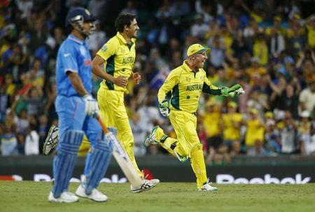 Australia's Starc and Haddin celebrate after India's Dhoni  was run out by Maxwell during their Cricket World Cup semi-final match in Sydney