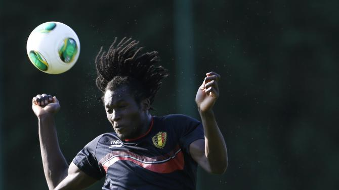 Belgian national soccer team players Lukaku jumps beside Fellaini during a training session in Brussels