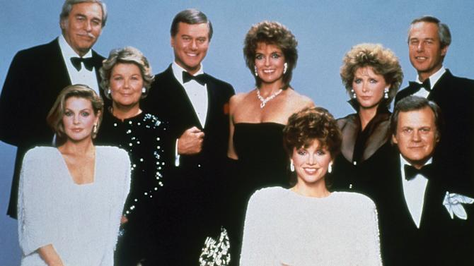 """FILE - This 1983 file photo shows actor Larry Hagman, center left, with fellow cast members of the television series """"Dallas."""" Back row from left are Howard Keel, Barbara Bel Geddes, Larry Hagman, Linda Grey, Susan Howard and Steve Kanaly. Front row from left are Priscilla Presley, Victoria Principal and Ken Kercheval.  Actor Larry Hagman, who for more than a decade played villainous patriarch JR Ewing in the TV soap Dallas, has died at the age of 81, his family said Saturday Nov. 24, 2012.  (AP Photo/CBS, File)"""