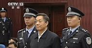 This screen grab taken from CCTV footage released on October 25, 2013 shows fallen politician Bo Xilai (front C) standing in the court room of Shandong High Court in Jinan, east China's Shandong province