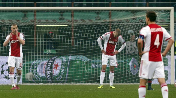Ajax Amsterdam's Sigthorsson, van der Hoorn and Moisander react after their Champions League soccer match against AC Milan in Milan