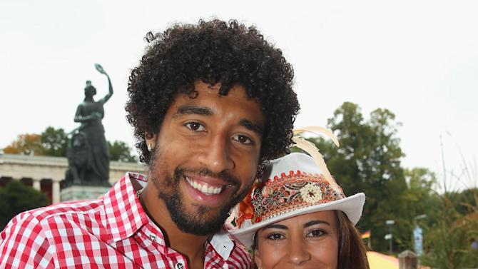 Dante of Bayern Munich poses with his wife Jocelina during their visit at the Oktoberfest beer festival in Munich, southern Germany, Sunday, Oct. 6, 2013