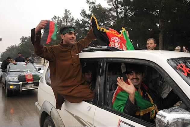 Afghan cricket fans waving national flag